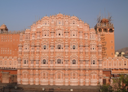 extends: Palace in Jaipur, India. It was built in 1799 by Maharaja Sawai Pratap Singh, and designed by Lal Chand Usta in the form of the crown of Krishna, the Hindu god. It forms part of the City Palace and extends the Zenana or womens chambers, the chambers of t Stock Photo