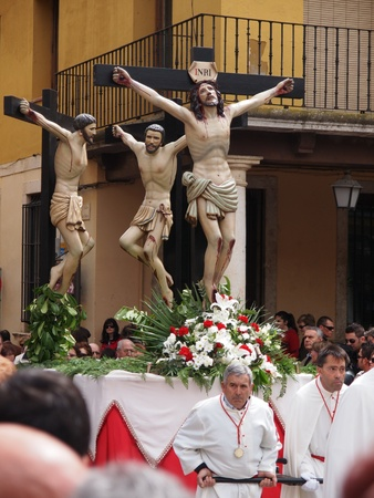 crucifixion: TORDESILLAS, SPAIN - APRIL 22: Holy week processionist and altar servers accompany Christ in the Tordesillas procession, Valladolid (Spain)  Editorial