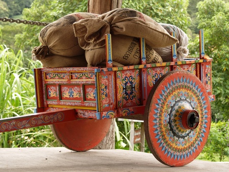 wagon: Colorful Costa Rican Ox Cart loaded with coffee bags