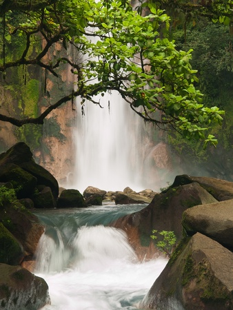 flowing river: Celestial blue waterfall in Costa Rica