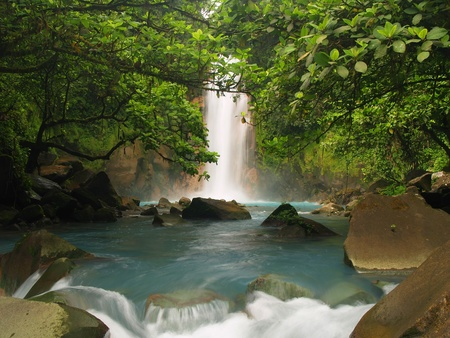 Celestial blue waterfall in Costa Rica  photo