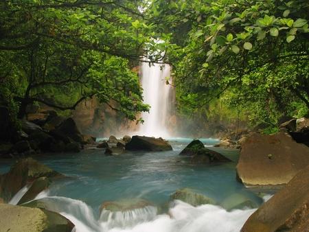 waterfall in forest: Celestial blue waterfall in Costa Rica
