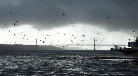 patrimony: The 25 De Abril Bridge in Lisbon Stock Photo
