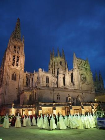 semana santa: BURGOS, SPAIN - APRIL 21: Bearers (nazarenos) in the Semana Santa Procession by Cathedral of Burgos on April 21, 2011 in Burgos, Spain. The conical hoods evokes an approach of the bearer to the sky