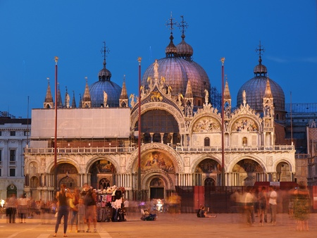 VENICE, ITALY - JULY 02: St Marks Square at dusk on July 02, 2011 in Venice, Italy. Thousands of tourist start enjoying the holiday season, the Piazza is the central landmark and gathering place for Venice.