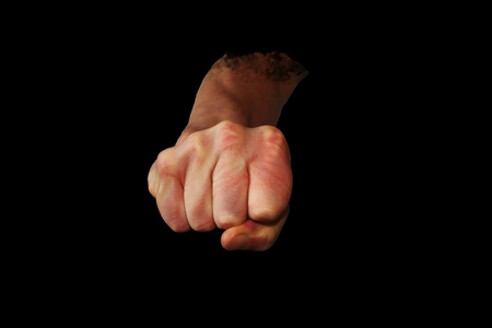 A Hand ready to punch with a black background