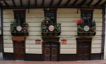 Old colonial houses with lots of flowers on the balkony, a typical holiday view 版權商用圖片