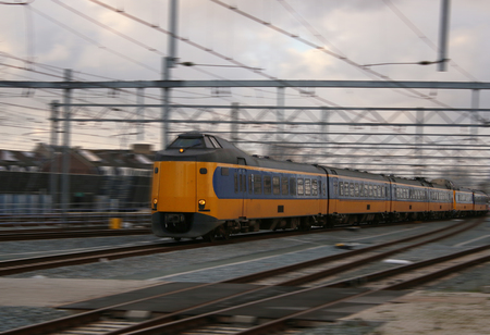 yellow train or intercity driving very quick with motion blur, a scenic wallpaper Banco de Imagens - 123829806