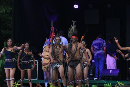 Puyo, Ecuador, 17-8-2019: An indigenous tribe called shiwuar performing their dance in traditional clothing and spears Editöryel