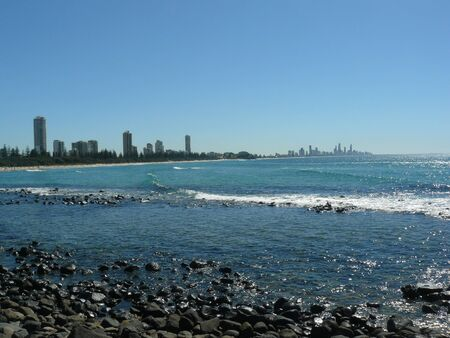View of Surfers Paradise from a large distance with the ocean and waves visible