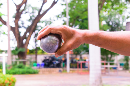 In the morning, the air was cool, the man was practicing throwing the boule. At the boulevard They work on their own. Enjoy and have fun. Petanque started in Thailand in 1965 and has been playing to this day. Exercise Good for the elderly It has always been promoted.
