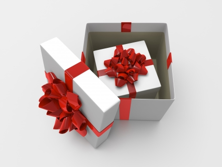 White opened giftbox with red ribbon and smaller box inside photo