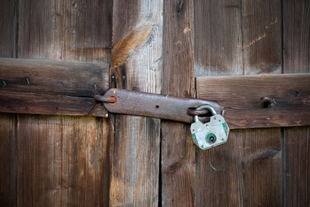 Old wooden door with padlock Stock Photo - 14759686