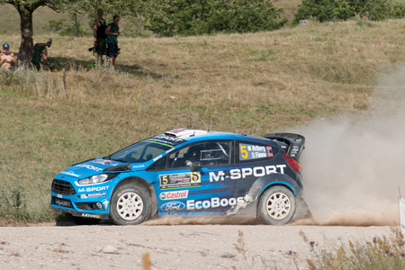MIKOLAJKI, POLAND - JUL 2: Mads Ostberg and his codriver Ola Floene in a Ford Fiesta RS WRC race in the 73nd Rally Poland, on July 2, 2016 in Mikolajki, Poland. Publikacyjne