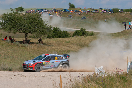 MIKOLAJKI, POLAND - JUL 2: Dani Sordo and his codriver Marc Marti in a Hyundai New Generation i20 WRC race in the 73nd Rally Poland, on July 2, 2016 in Mikolajki, Poland. Publikacyjne