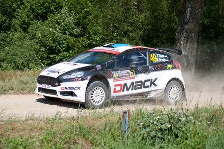 MIKOLAJKI, POLAND - JUL 1: Karl Kruuda and his codriver Martin Jarveoja in a Ford Fiesta R5 race in the 73nd Rally Poland, on July 1, 2016 in Mikolajki, Poland.