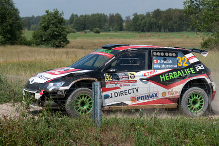 MIKOLAJKI, POLAND - JUL 1: Nicolás Fuchs and his codriver Fernando Mussano in a Škoda Fabia R5 race in the 73nd Rally Poland, on July 1, 2016 in Mikolajki, Poland.