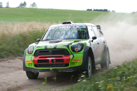 MIKOLAJKI, POLAND - JUL 1: Valeriy Gorban and his codriver Volodymyr Korsia in a BMW-Mini John Cooper Works race in the 73nd Rally Poland, on July 1, 2016 in Mikolajki, Poland.