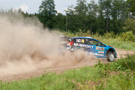 MIKOLAJKI, POLAND - JUL 1: Eric Camilli and his codriver Benjamin Veillas in a Ford Fiesta RS WRC race in the 73nd Rally Poland, on July 1, 2016 in Mikolajki, Poland. Publikacyjne