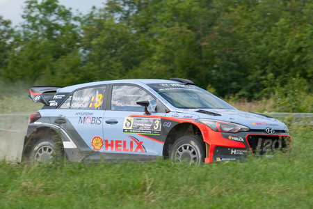 MIKOLAJKI, POLAND - JUL 1: Thierry Neuville and his codriver Nicolas Gilsoul in a Hyundai New Generation i20 WRC race in the 73nd Rally Poland, on July 1, 2016 in Mikolajki, Poland.
