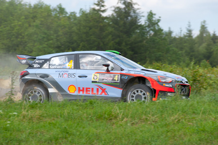 MIKOLAJKI, POLAND - JUL 1: Hayden Paddon and his codriver John Kennard in a Hyundai New Generation i20 WRC race in the 73nd Rally Poland, on July 1, 2016 in Mikolajki, Poland.