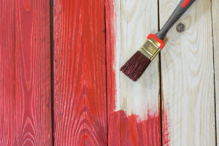 Wooden Plate with a Brush while Painting to Red Color