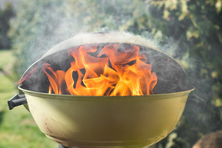 gas fireplace: Fire and Smoke and burning charcoal in a grill Stock Photo