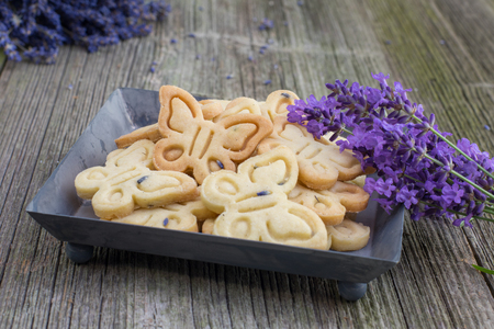 biscuits: Butterflies Butter Biscuits Cookies with Lavender on Sheet tray on Old Wooden Board Stock Photo