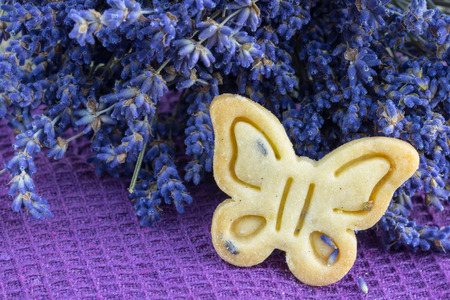 biscuits: Detail on Butter Biscuits Cookies with Lavender Butterfly shape on violet cloth