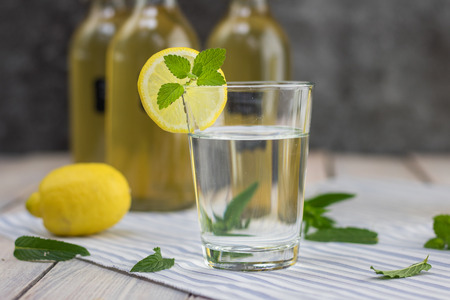 Home made lemonade in a glass   with mint syrup and lemon slice