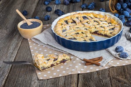 Slice of a Plum and poppy seeds pie in cake form