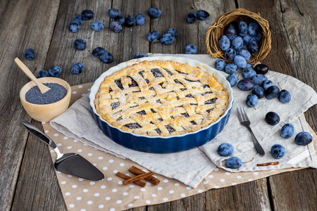 Plum and poppy seeds pie with plums and cinnamon in cake form