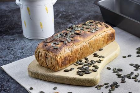 Detail on a Rye leaven bread with pumpkin seeds on wooden board