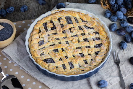 Detail  on a Plum and poppy seeds pie with plums in cake form