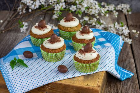 nettle cupcake with mascarpone and white chocolate cream and chocolate easter egg