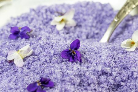 violet sugar from violet flowers with teaspoon