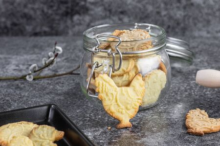 Easter butter biscuits with embossed pattern in glass jar