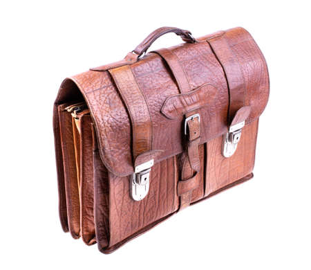 Brown Vintage leather briefcase with strap and brass buckle on white