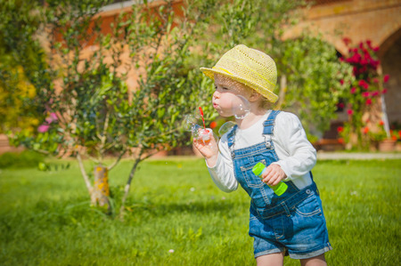 Little helper on the green  grass in summer day photo