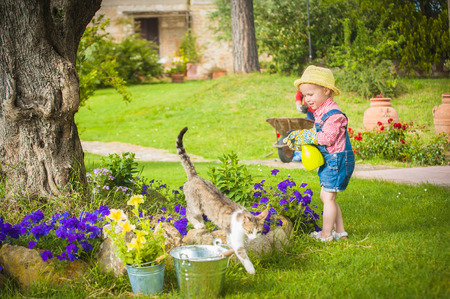 Little girl helping in the garden photo
