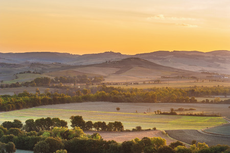 The rising sun over the Tuscan fields photo