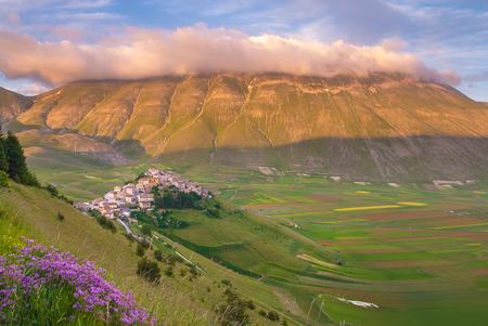 Summer day in the beautiful and colorful area of Castelluccio di Norcia, Italy Фото со стока