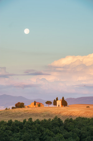 orcia: Tuscan famous chapel Vitaleta at the full moon, Italy