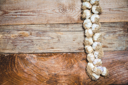 Wild garlic on a rustic wooden table photo