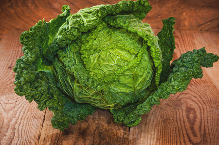 tabel: Savoy cabbage on wooden rustic tabel Stock Photo