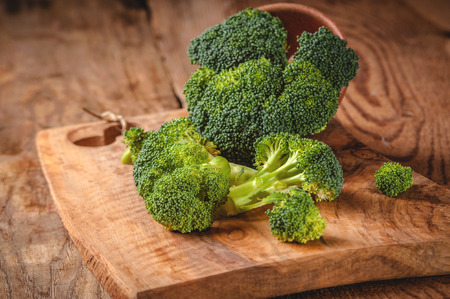Green delicious broccoli on a wooden rustic table