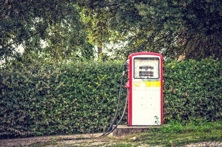 fuelling pump: Old and abandoned fuel distributor in vintage style, Stock Photo