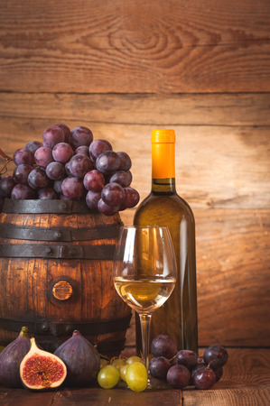 tabel: Fig with white wine, grape and barrel on rustic wood tabel Stock Photo