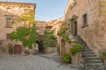 Small alley in the Tuscan village Фото со стока