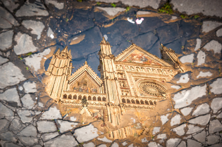 orvieto: Reflection in puddle of water the cathedral in Orvieto, Umbria